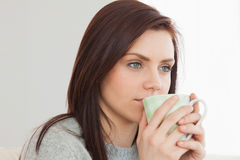 Thoughtful girl drinking a cup of coffee Stock Images