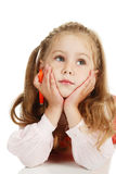 The thoughtful girl with a felt-tip pen Royalty Free Stock Photography