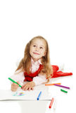 The thoughtful girl with a felt-tip pen royalty free stock images
