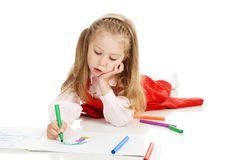 The thoughtful girl with a felt-tip pen stock photo