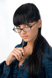 Thoughtful girl in glasses stock photo