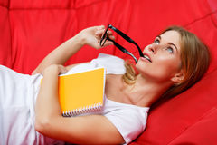 Thoughtful girl with glasses in hands on hammock Royalty Free Stock Image
