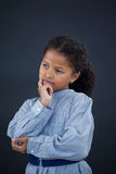 Thoughtful girl with hand on chin Stock Photography