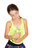 Thoughtful Girl Holding Bottle of Mineral Water Stock Images