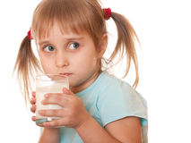 Thoughtful girl holding glass of milk Stock Photography