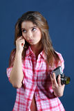 Thoughtful girl holds old camera and looks up Stock Photography