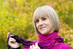 Thoughtful girl holds a scarf Royalty Free Stock Images