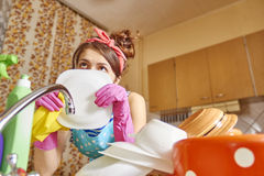 Thoughtful girl in the kitchen Stock Photography