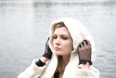 The thoughtful girl in  knitted dress Stock Photography
