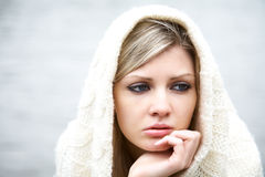 The thoughtful girl in  knitted dress Stock Images