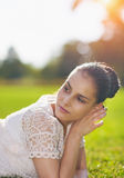 Thoughtful girl laying on grass Royalty Free Stock Image