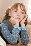 Thoughtful girl at a lesson Royalty Free Stock Photography