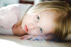 Thoughtful girl looking into camera royalty free stock photo