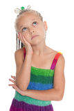 Thoughtful girl looking up. The girl is six years old Royalty Free Stock Photography