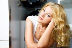 Thoughtful girl near the wardrobe stock photos