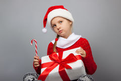 Thoughtful girl with a New Year gift Royalty Free Stock Photo