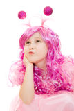 Thoughtful girl with pink hair in a pink dress Royalty Free Stock Photo