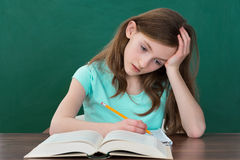 Thoughtful Girl Reading Books Royalty Free Stock Images