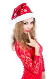 Thoughtful girl Santa in a red dress looking at the camera Royalty Free Stock Photo