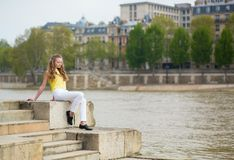 Thoughtful girl on the Seine embankment Stock Photography