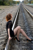 Thoughtful girl sitting on rails Stock Photography