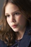 Thoughtful Girl Sitting In Studio Stock Photo