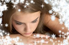 Thoughtful girl with snowflake Stock Photos