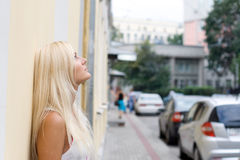 Thoughtful girl standing on street Stock Photo
