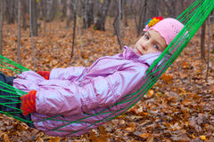 Thoughtful girl swinging in a hammock Royalty Free Stock Photo