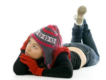 Thoughtful girl in winter cap Stock Photos
