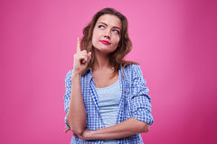 Free Thoughtful Girl With Index Finger Up Planning Something Stock Photography - 86980092