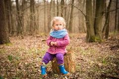 Thoughtful girl in the wood Royalty Free Stock Image