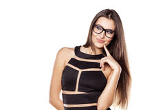 Thoughtful girl. Thoughtful young woman with glasses on a white background stock photos