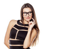 Thoughtful girl. Thoughtful young woman with glasses on a white background royalty free stock photos
