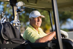 Thoughtful golfer man looking away Royalty Free Stock Photos