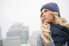 Thoughtful gorgeous blonde posing outdoors Stock Photos