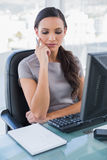 Thoughtful gorgeous businesswoman posing Stock Images
