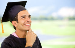 Thoughtful graduation man Royalty Free Stock Photos