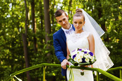 Thoughtful groom and bride behind handrail royalty free stock photos
