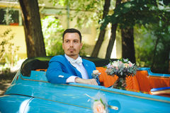 Thoughtful Groom in Car. Portrait of thoughtful groom in blue car Royalty Free Stock Photos