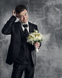 Groom with wedding flowers bouquet Stock Images
