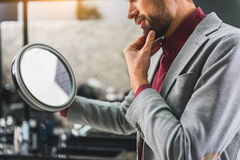 Thoughtful guy is ready to shave Royalty Free Stock Images