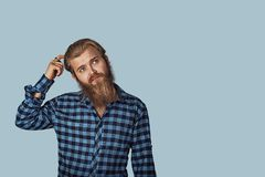 Thoughtful guy scratching head solving a problem royalty free stock images