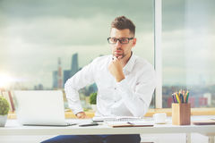 Thoughtful guy at workplace Royalty Free Stock Photography