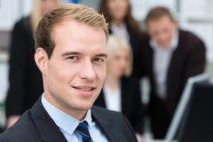 Thoughtful handsome business executive Royalty Free Stock Photos