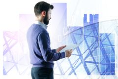 Report and job concept. Thoughtful handsome young european businessman holding document on abstract city background with copy space. Report and job concept stock images