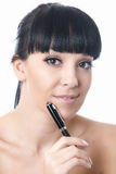 Thoughtful Happy Attractive Young Woman Holding a Pen Royalty Free Stock Photo