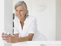 Thoughtful Happy Middle Aged Woman Looking Away Stock Image