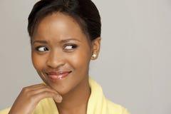 Thoughtful happy woman stock photo
