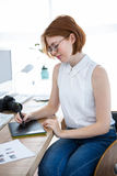 Thoughtful hipster businesswoman with a digital drawing tablet Royalty Free Stock Image